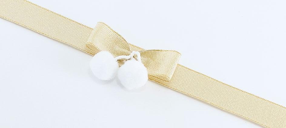 noeud textile or avec pompon blanc