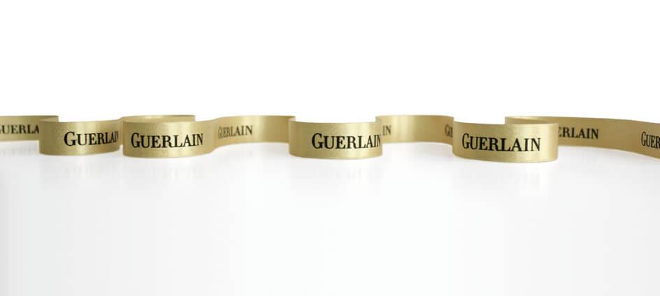 Ruban imprimé doré impression noir Guerlain