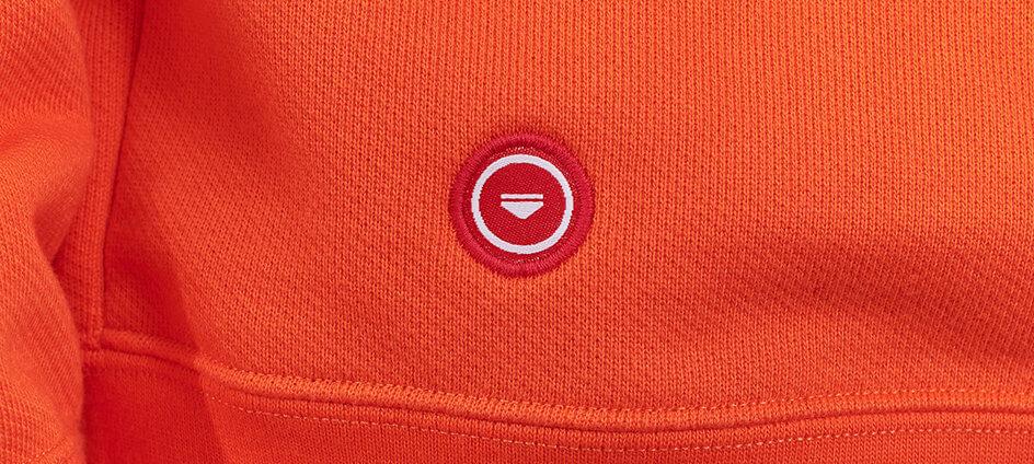 cocarde tissée polyester recyclé le slip francais rouge sur pull rouge